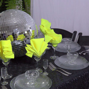 black and green linen place setting