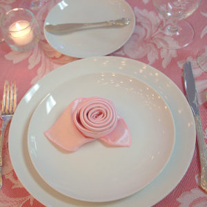 pink linen place setting