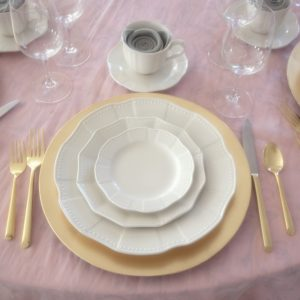 pink and gold linen place setting