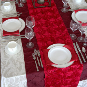 white and red linen place setting