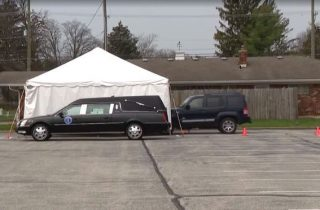 drive thru tent for viewing of casket